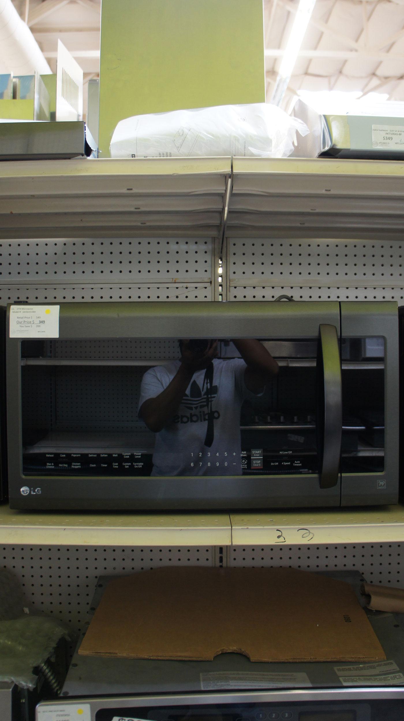 2.0 cu.ft. LG LMVM2033BM Over-The-Range Microwave Oven